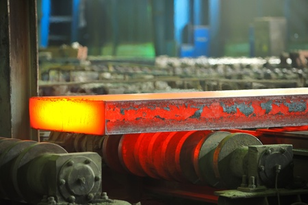 steel factory: hot steel on conveyor
