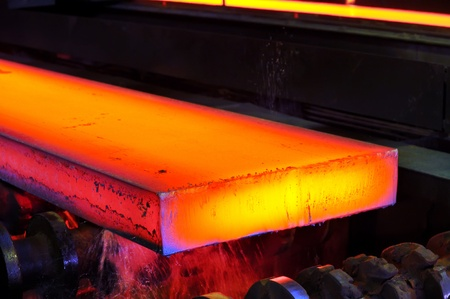 hot steel on conveyor Stock Photo - 11931611