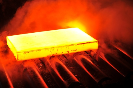 red hot iron: hot steel on conveyor  Stock Photo