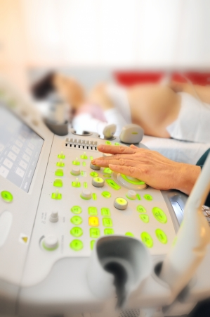 gestation: medical examining pregnant Stock Photo