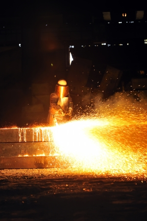 worker using torch cutter to cut through metal Stock Photo - 16475386
