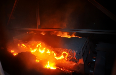molted: hot ore on conveyor Stock Photo