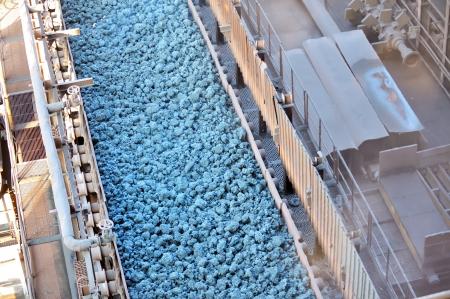 hot ore on conveyor Stock Photo - 16480297