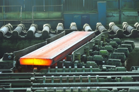 hot steel on conveyor Stock Photo - 16476685