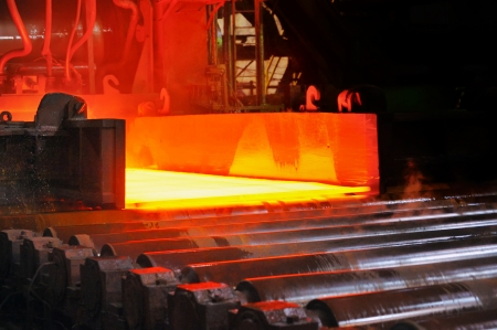 hot steel on conveyor Stock Photo - 16476734
