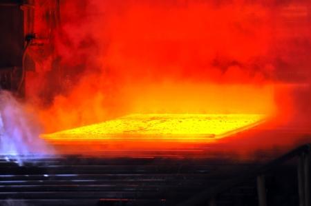 foundry: hot steel on conveyor