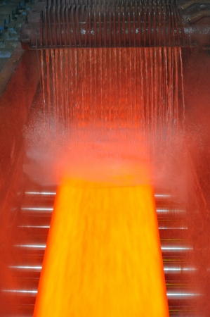 cooling hot steel on conveyor photo