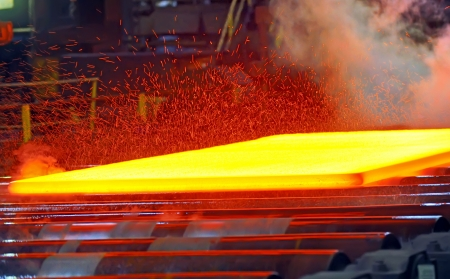 rolling: hot steel on conveyor  Stock Photo