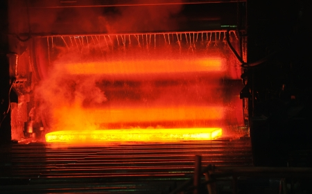hot steel on conveyor Stock Photo - 16475405