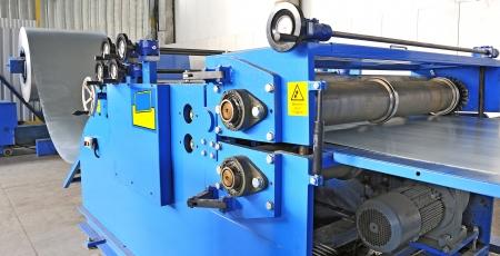 heavy equipment operator: machine for rolling steel sheet in warehouse