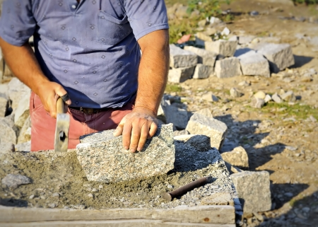 man chiseling stone  Stock Photo - 20778116