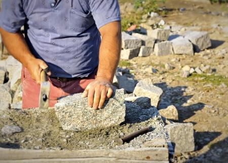 craftman: man chiseling stone