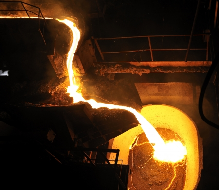 cast: Molten hot metal pouring Stock Photo