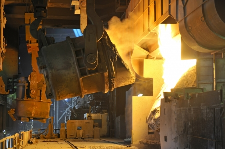 casting: Molten hot metal pouring Stock Photo