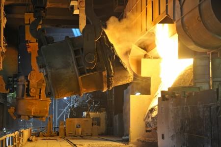 Molten hot metal pouring Stock Photo