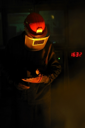 foundry:  worker with hot metal