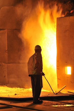 worker with hot steel Stock Photo - 20778135