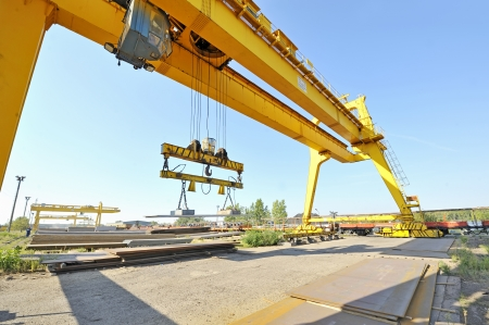 crane and steel plates photo