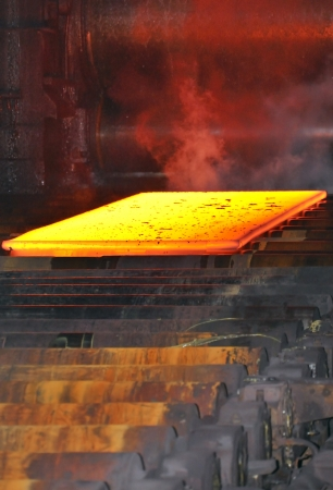 hot steel on conveyor Stock Photo - 16477618