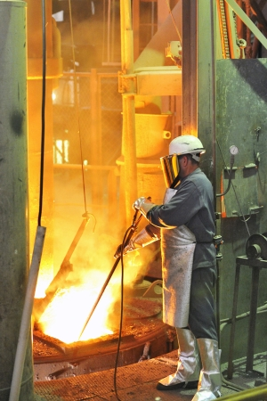 mill worker with hot steel Stock Photo