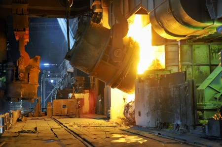 blastfurnace: Pouring of liquid metal inside of plant Stock Photo
