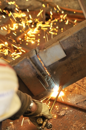 worker using torch cutter to cut through metal Stock Photo - 16478127