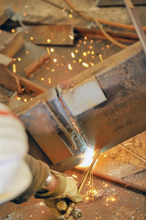 worker using torch cutter to cut through metal Stock Photo - 16478237