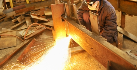 worker using torch cutter to cut through metal Stock Photo - 16475828