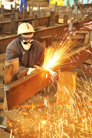 worker using torch cutter to cut through metal Stock Photo - 20778081