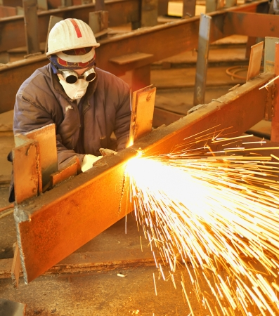 worker using torch cutter to cut through metal Stock Photo - 16476514