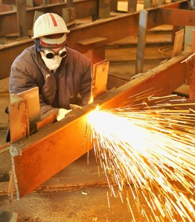 cut through: worker using torch cutter to cut through metal Stock Photo