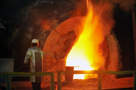 Molten hot steel pouring and worker Stock Photo - 16475342