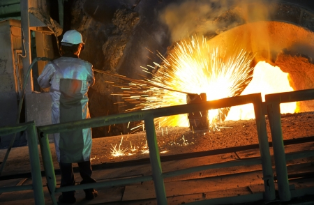 bussines people: Molten hot steel pouring and worker