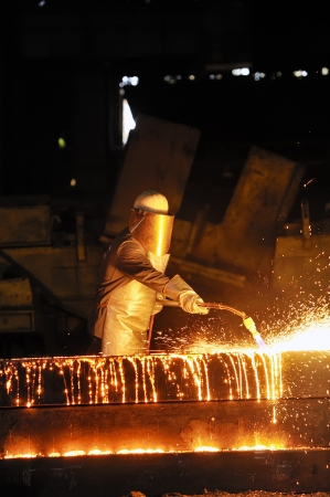 worker using torch cutter to cut through metal Stock Photo - 16476889