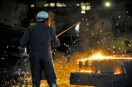 worker using torch cutter Stock Photo