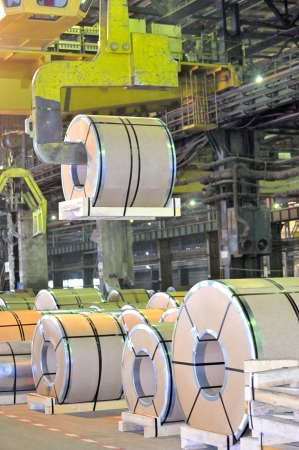 ironworks: loading of metal on a roll in the plant