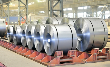 steel factory: rolls of steel sheet in a warehouse  Stock Photo