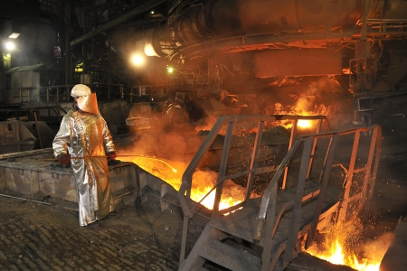 Molten hot steel pouring and worker  Stock Photo - 16476254