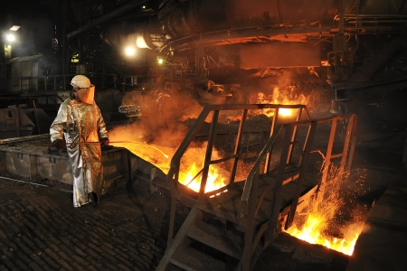 furnace: Molten hot steel pouring and worker
