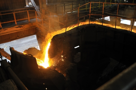 Molten hot steel pouring photo