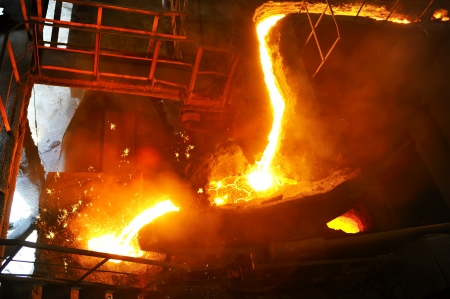 pouring molten steel in transportation device photo