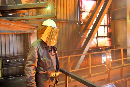 mill worker with hot steel Stock Photo - 16476965