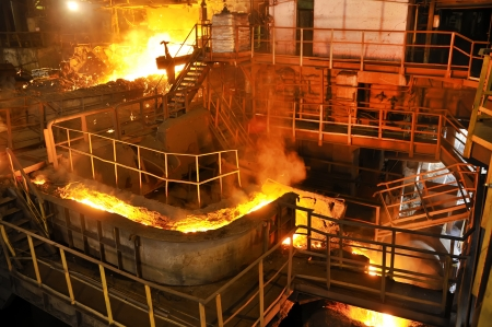 foundry: pouring molten steel