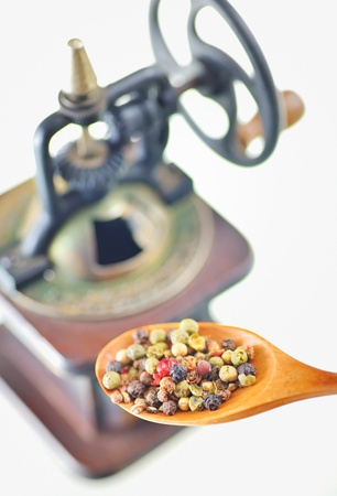 pepper mill and spoon with different peper assorted Stock Photo - 16474198