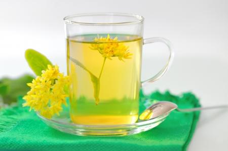 linden tea: cup of linden tea and flowers