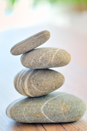 river stones: a pile of pebbles isolated Stock Photo