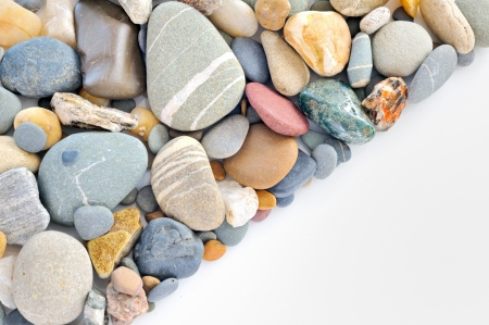 Pebble Beach: a pile of pebbles isolated Stock Photo