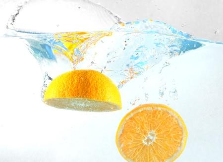 Orange falls into the water Stock Photo - 16474573