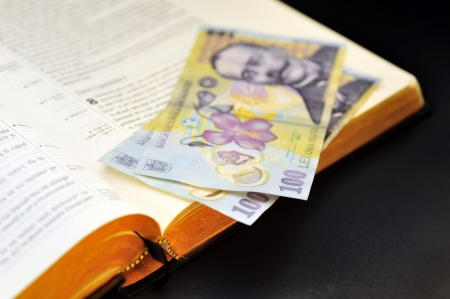 leu: offering  romanian currency and holy bible
