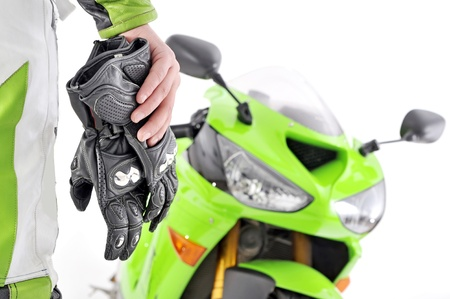 motorcycle gloves with carbon and bike Stock Photo